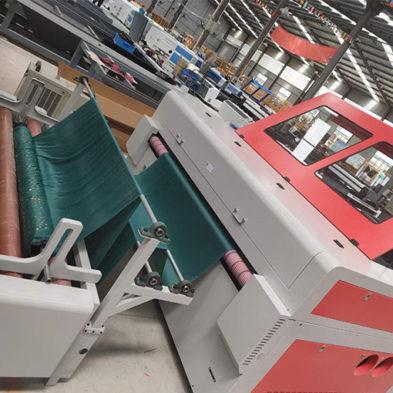 Auto-Feeding Double Heads Fabric Laser Cutting Machine