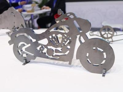 Fiber laser machine cutting metal display